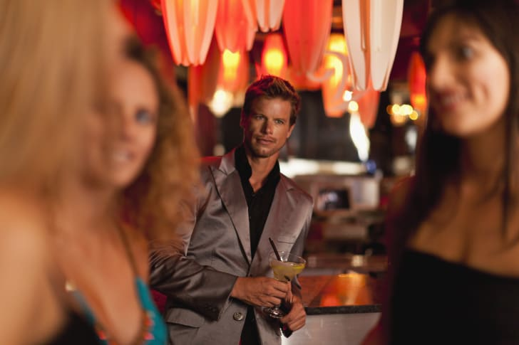 A man staring at women in a bar.
