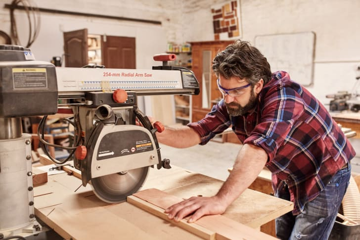 Carpenter using radial arm saw