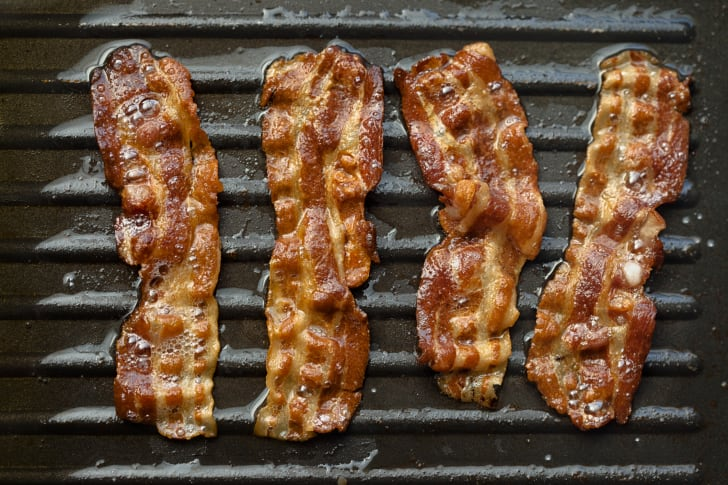 Image of bacon sizzling on a grill