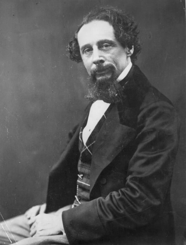 Author Charles Dickens poses for a photo