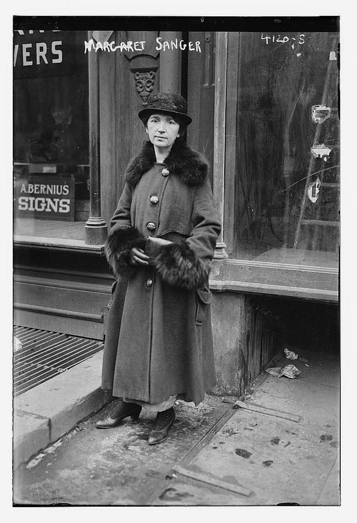 Historical image of Margaret Sanger standing on a street in New York City