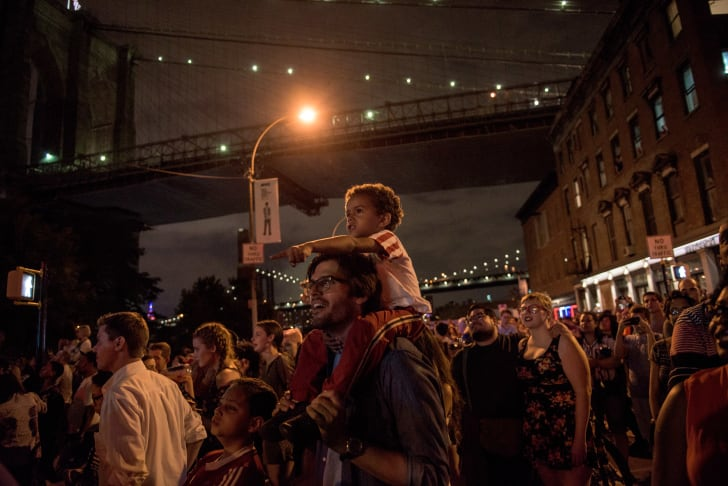 People watch the Macy's Fourth of July Fireworks from outside Brooklyn Bridge Park in 2015