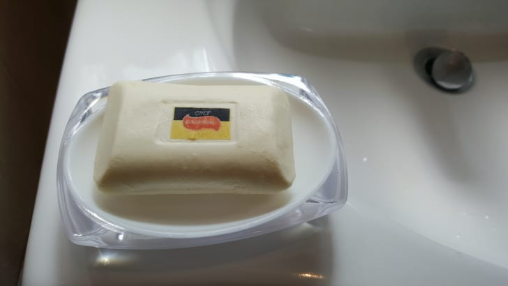 This looks like a bar of soap, but it's actually a delicious dessert sitting on a soap dish