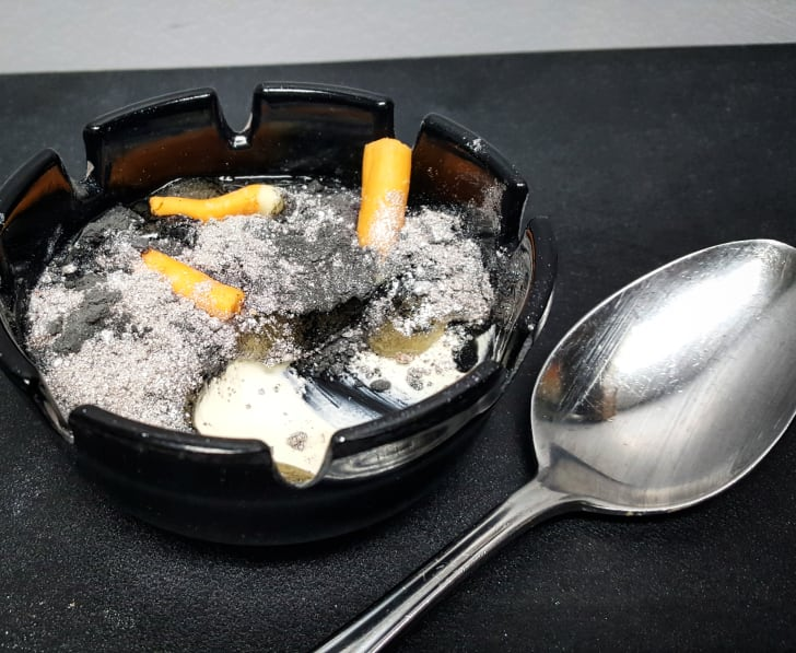 Dessert shaped like an ashtray with a spoon next to it
