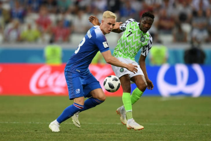 Players from Iceland and Nigeria vie for a soccer ball in play