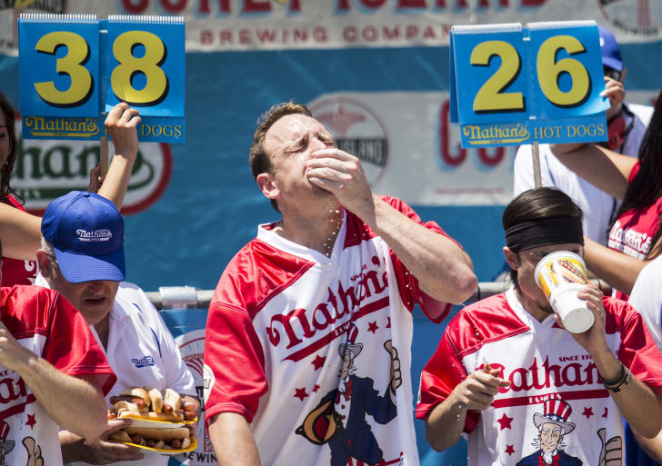 Image of competitors at the Nathan's Famous hot dog eating competition in 2017 (I think)