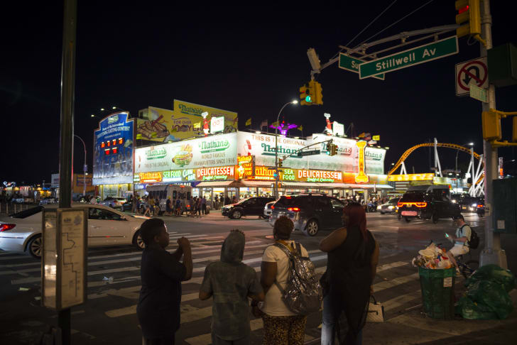 Image of the original Nathan's Famous Coney Island location at night