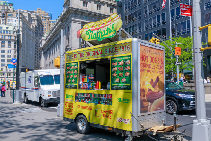 Image of a Nathan's Famous food cart on a street in New York City