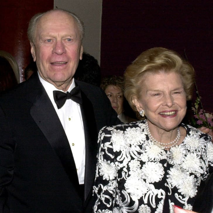 Gerald Ford stands next to wife Betty during a public appearance