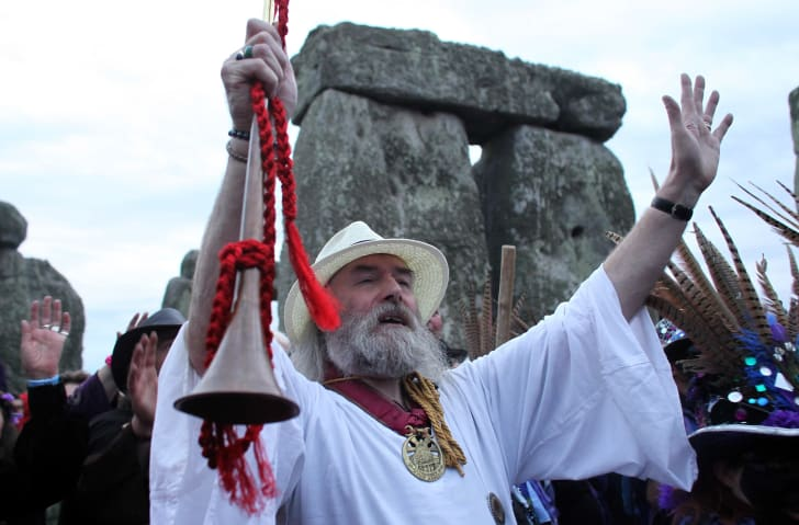 Rollo Maughfling, the Archdruid of Glastonbury and Stonehenge, conducts a Solstice celebration service for revelers as they wait for the midsummer sunrise at Stonehenge on June 21, 2012, near Salisbury, England.