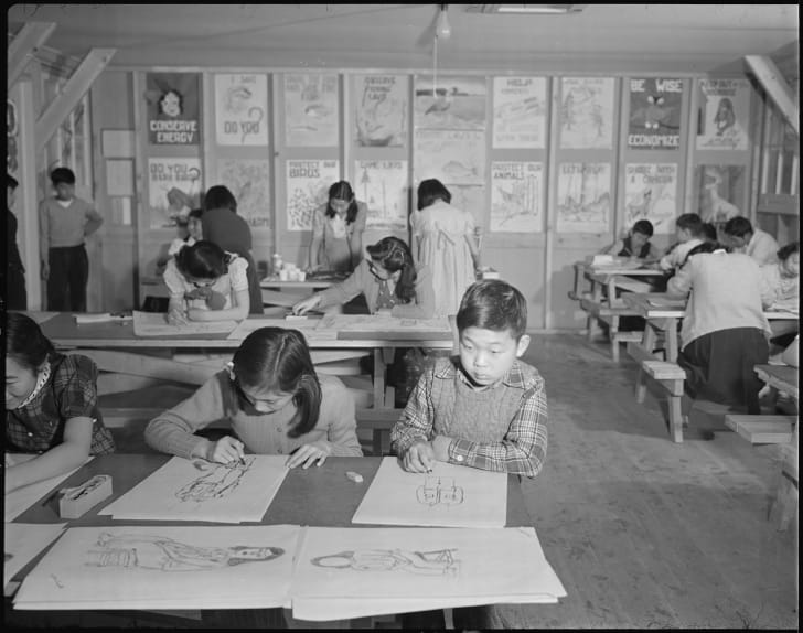 Children in a drawing class at Minidoka Relocation Center