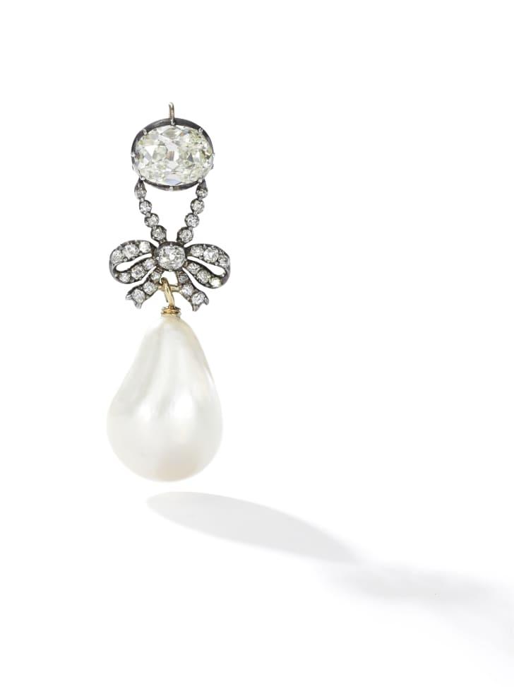A diamond and pearl pendant