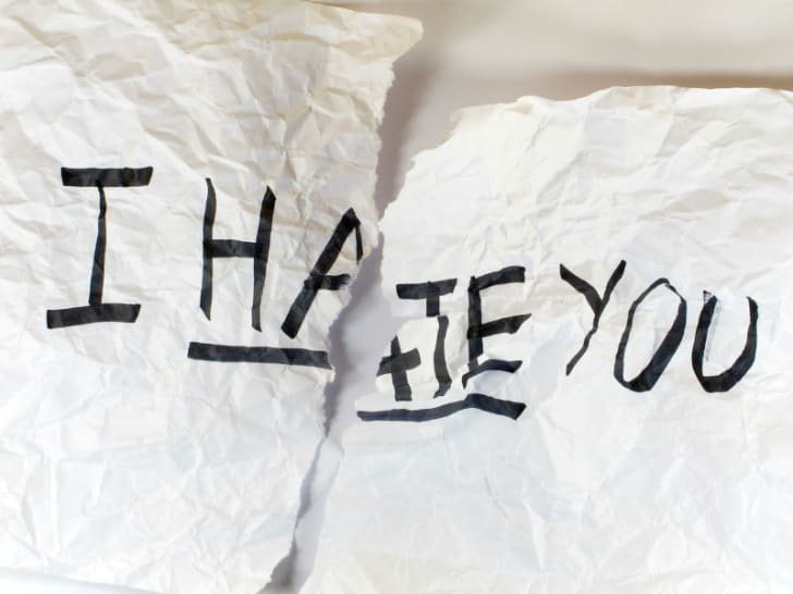 A hateful message is written out on paper
