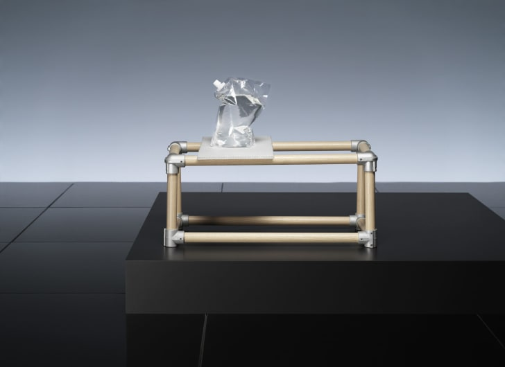 Modular furniture holding water bag.