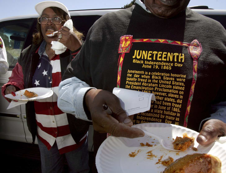 Juneteenth celebration participants taste the sweet potato pie entered in the cook-off contest during the festivities Richmond, California, in 2004.