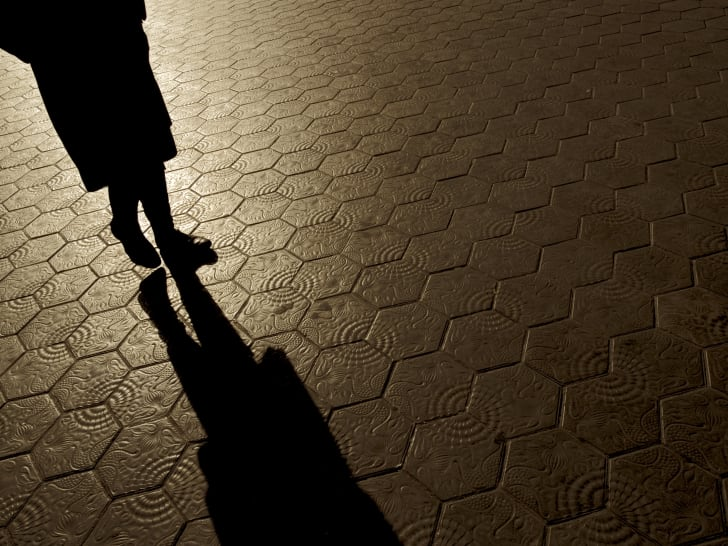 Silhouette of woman walking