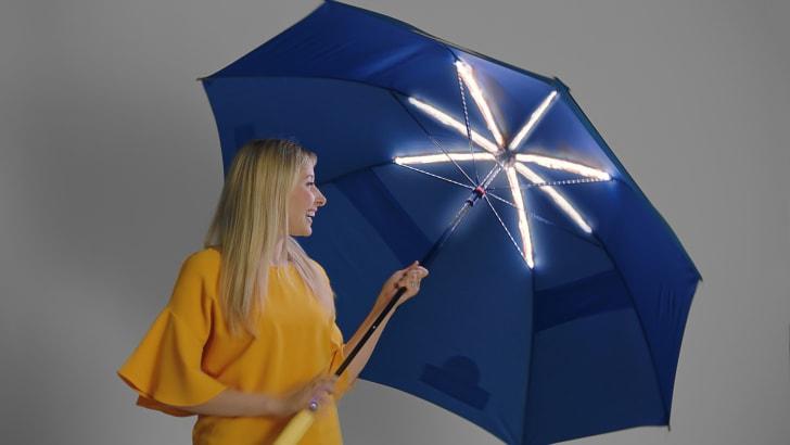 Woman with illuminated umbrella.
