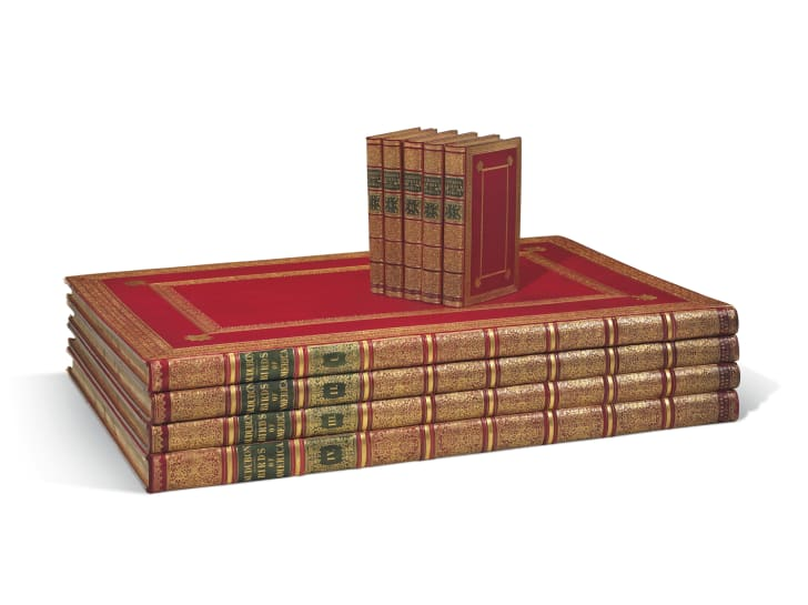 Set of red leather-bound books.