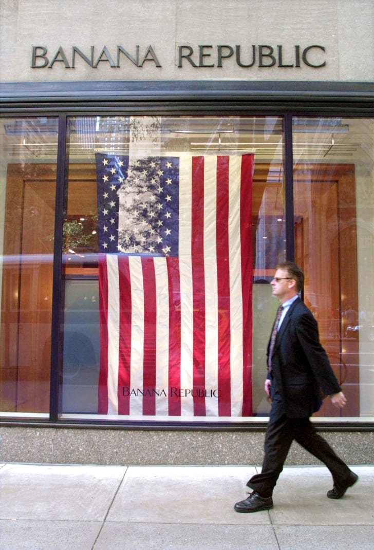 American flag hanging in the window of a Banana Republic