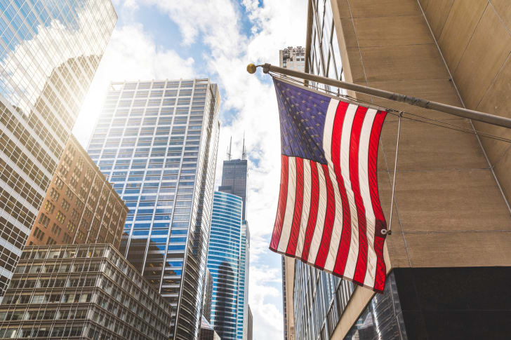 American flag on city street