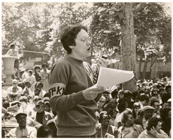 Barbara Gittings speaking at an event.