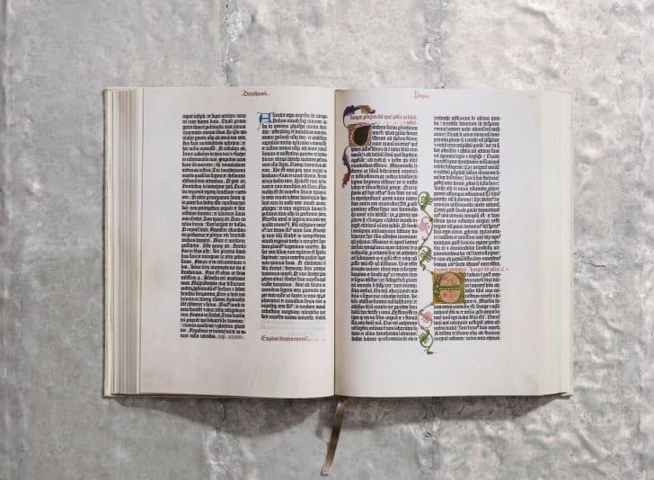 An open copy of Taschen's Gutenberg Bible