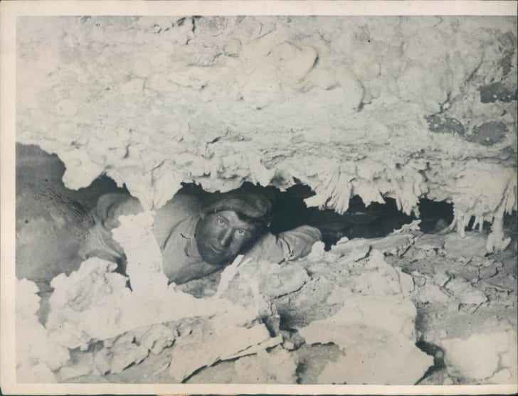 Floyd Collins navigates a tight spot in Crystal Cave.