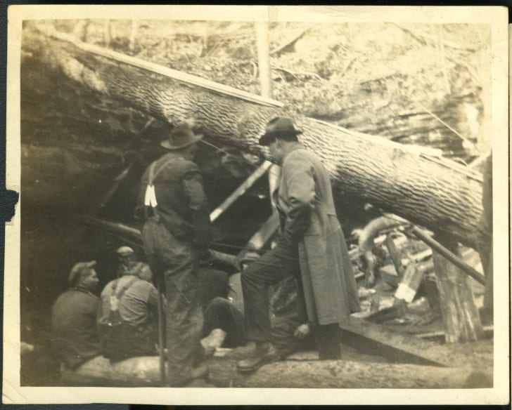 Men waiting near the entrance of Sand Cave.