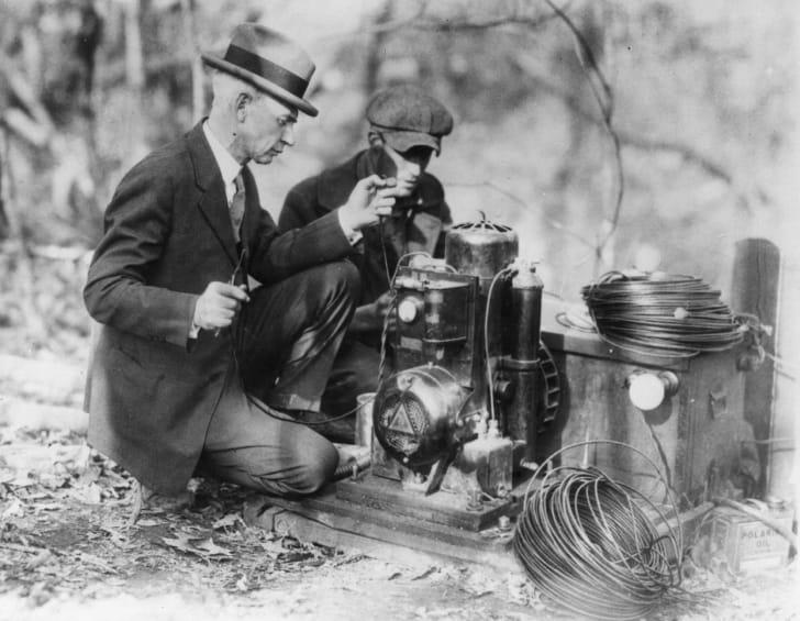 Men testing a radio.