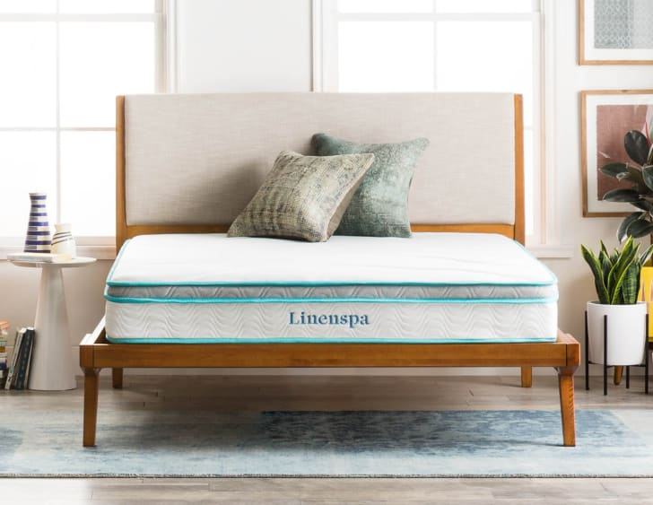 A bare mattress from Linenspa in a bedroom