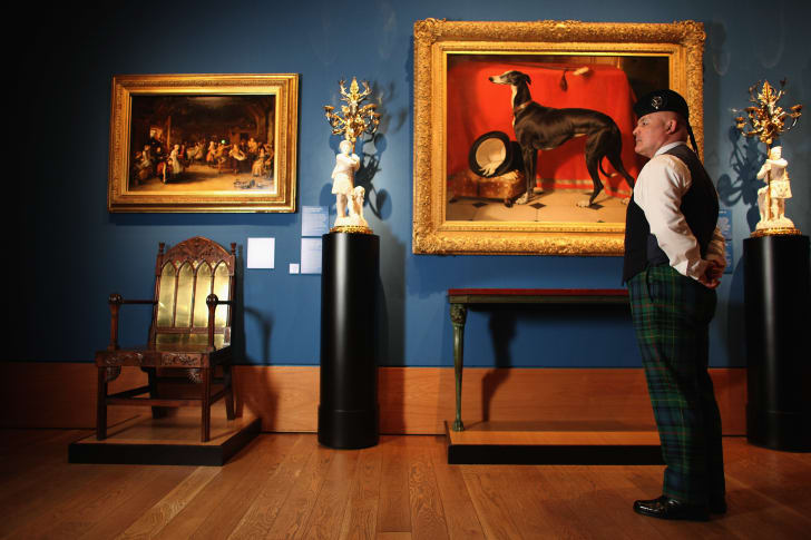 A member of staff at the Queens Gallery views a painting in the Royal Collection on March 13, 2012 in Edinburgh, Scotland
