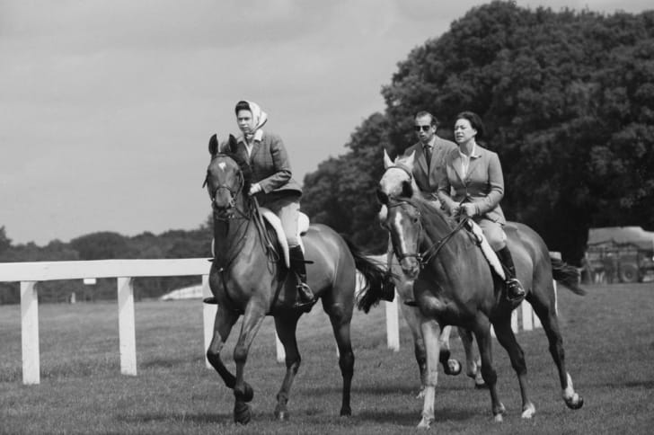 Queen Elizabeth II, Princess Margaret, Countess of Snowdon (1930 - 2002), and Prince Edward, Duke of Kent, riding at Ascot Racecourse, UK, 27th June 1968