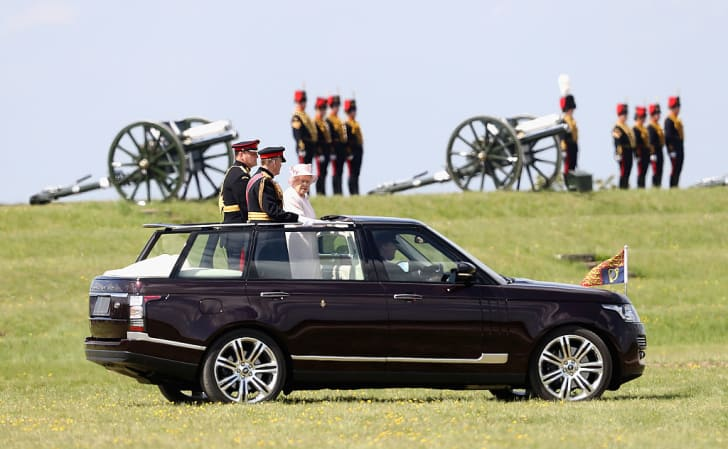 Queen Elizabeth II, Captain-General of the Royal Regiment of Artillery, oversees a Royal Review from an open-top Range Rover on the occasion of their Tercentenary at Knighton Down on May 26, 2016 in Lark Hill, England