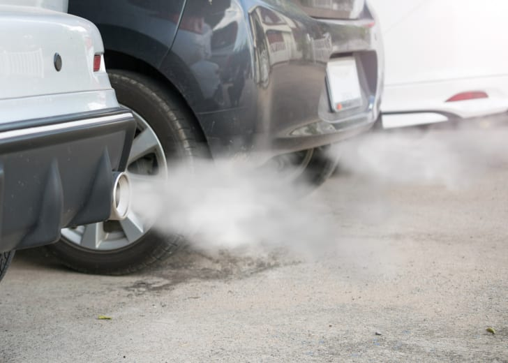 Car exhaust emits smoke.