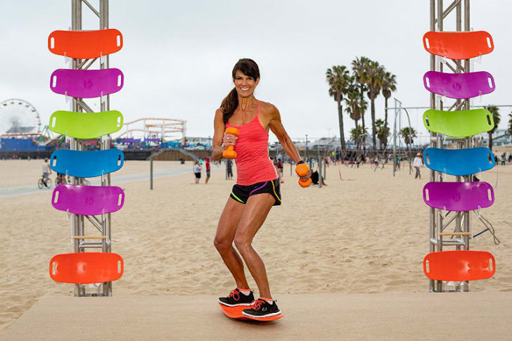 A model demonstrates the Simply Fit exercise board