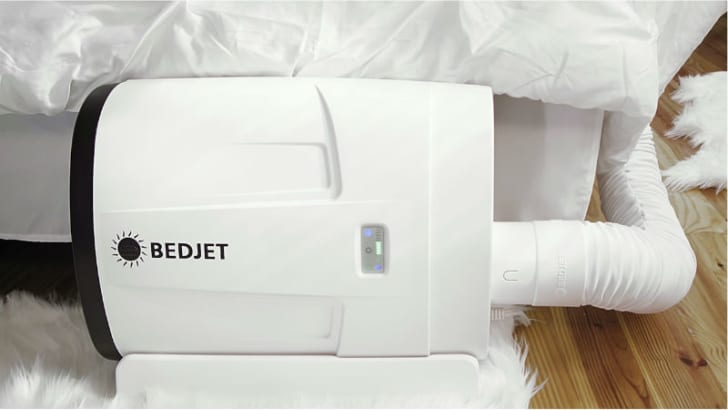 A BedJet device sits next to a mattress