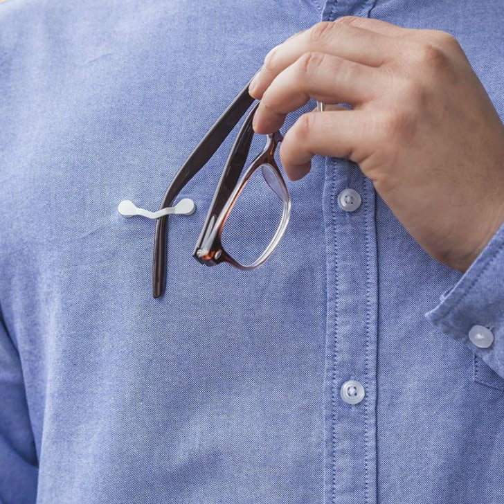 A model demonstrates the ReadeRest eyeglass clip