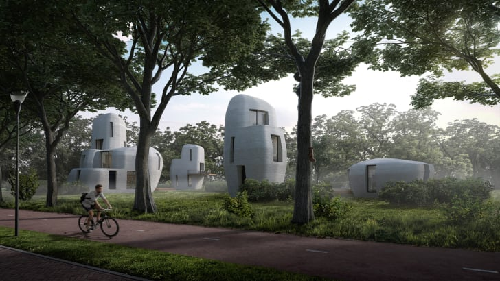 A rendering of boulder-like homes in the middle of a field
