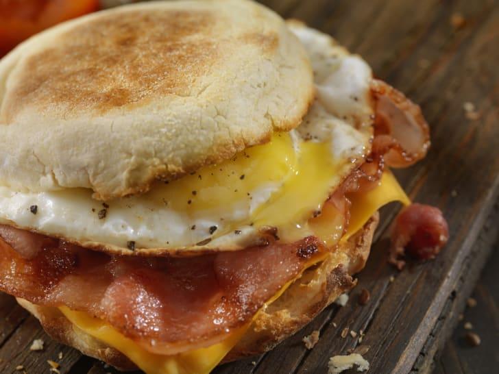 Breakfast sandwich on table.