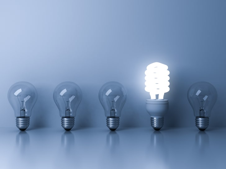 Line of light bulbs against wall.