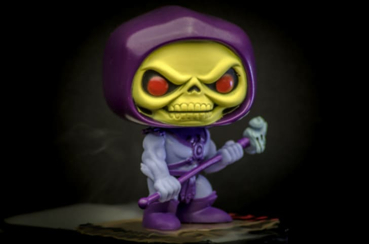 A Funko Pop! of Skeletor poses with his staff