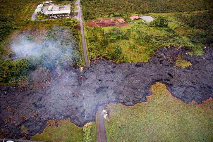 lava cools as it flows across a field in Hawaii