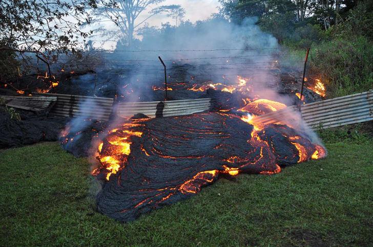 lava flows through metal fence