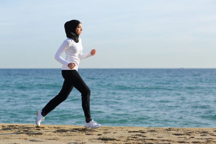 Woman running on the beach.