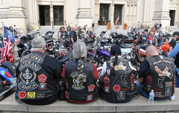 Rolling Thunder members and motocyclists wait for the 'Blessing of the Bikes' to start at at the Washington National Cathedral, May 26, 2017 in Washington, DC