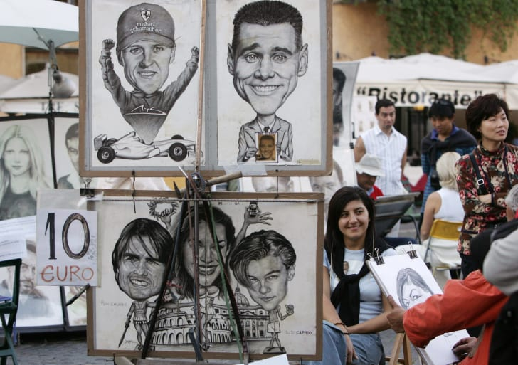 Tourists look at caricaturists in Rome