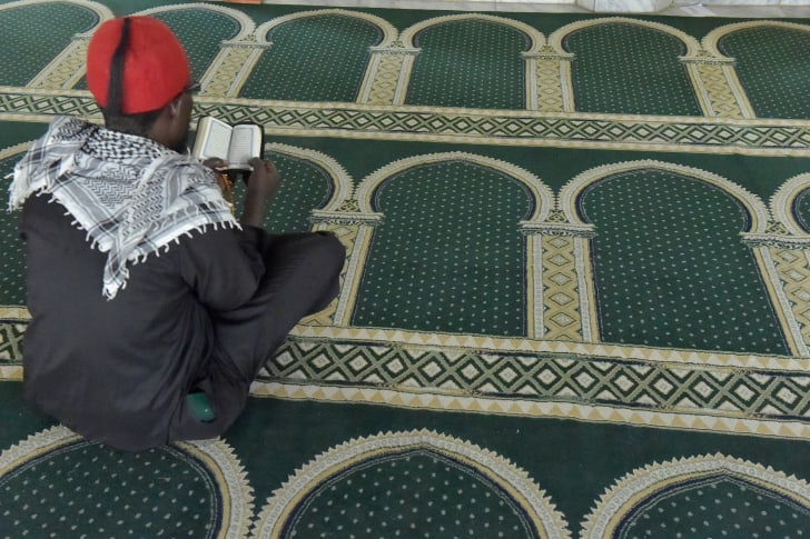 A Muslim man reads from the Koran at a Mosque in Nairobi on May 17, 2018 during the first day of the Islamic holy month of Ramadan.