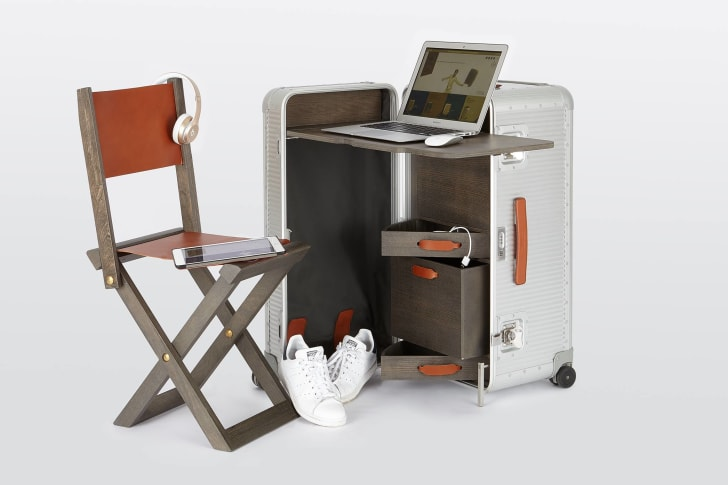 A suitcase with a built-in desk and drawers