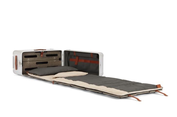 A suitcase converts to a pull-out bed
