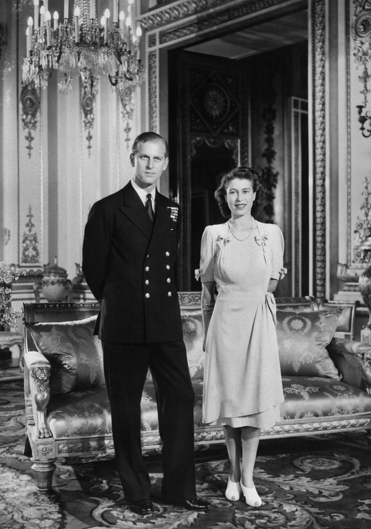 Princess Elizabeth (future Queen Elizabeth II) and her Fiance Philip Mountbatten (also the Duke of Edinburgh) pose in the Buckingham Palace on July 09, 1947 in London, the day their engagement was officially announced.